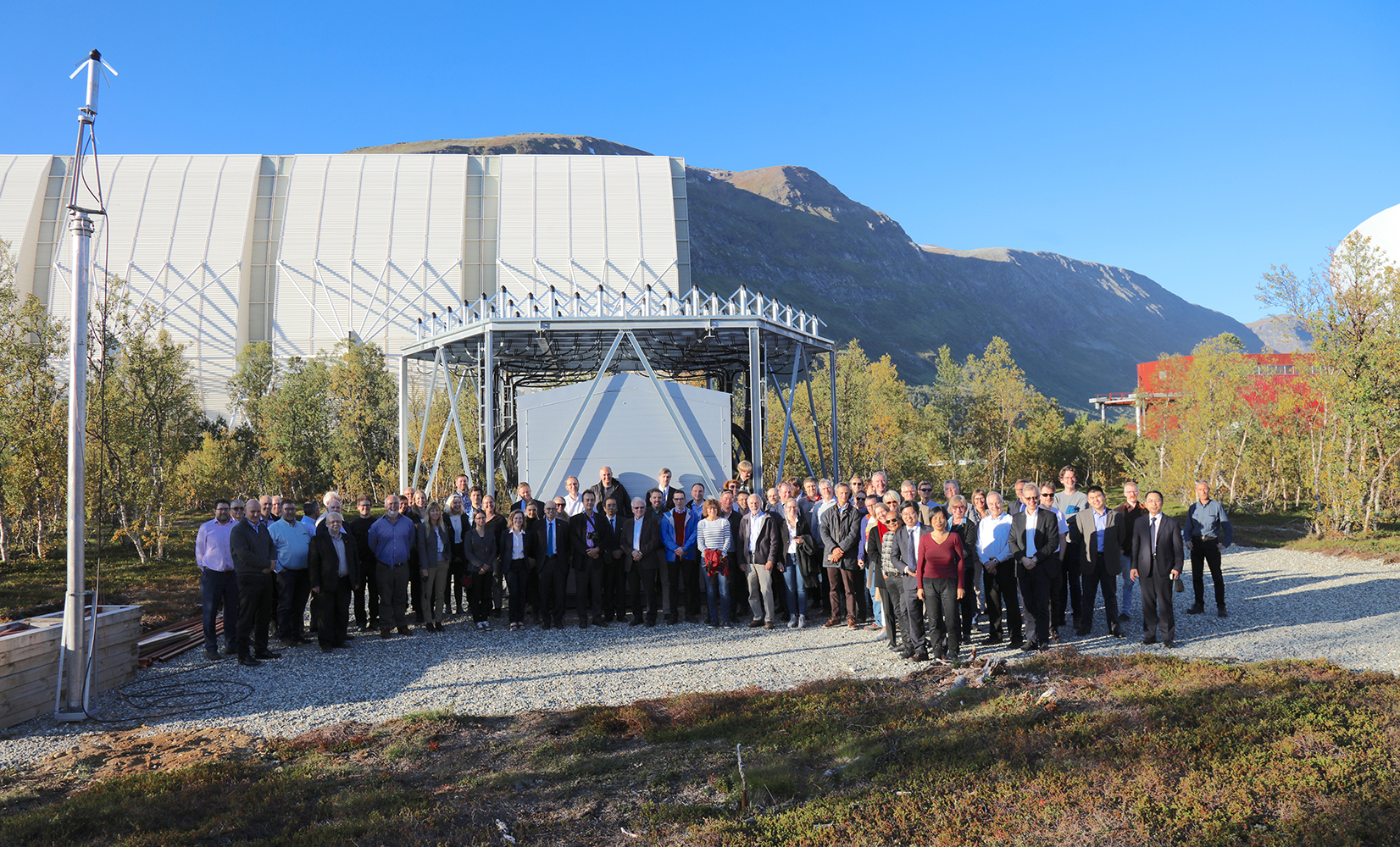 Group photo of EISCAT_3D kick-off participants infront of the EISCAT_3D test site in Ramfjordmoen.